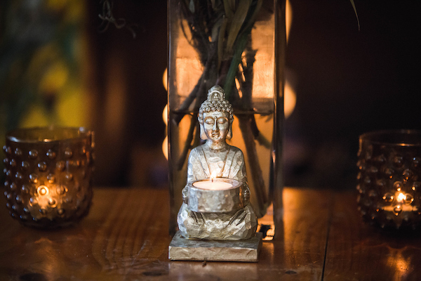 Image of buddha statue with a candle